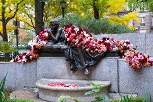 Flowers Draped Across Sculpture
