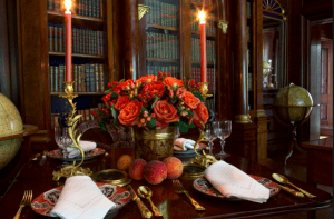 Candles And Flowers On Dining Table
