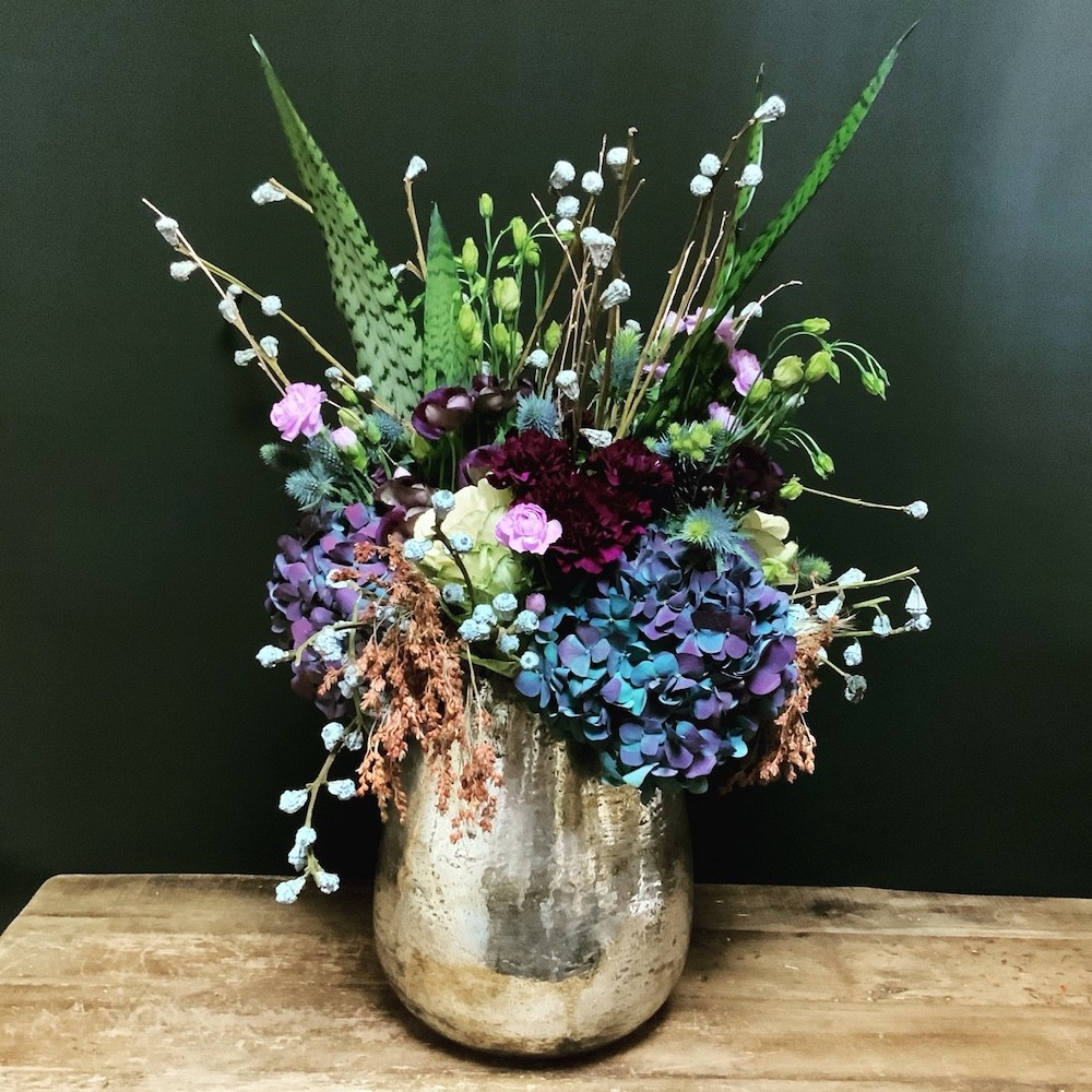 Floral arrangement using blue for Chanukah
